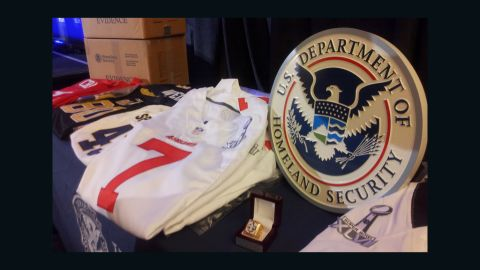 """Fake jerseys, hats, T-shirts, jackets and other souvenirs were among the items seized in """"Operation Red Zone."""""""