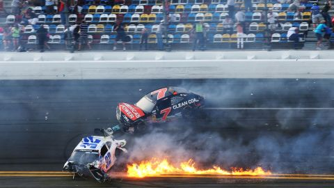 Larson and Regan Smith, in the No.7 car, slide across the track after the accident.