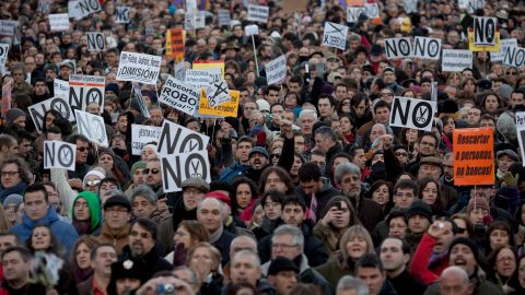 Demonstrators shout slogans at Neptuno Square during a march made by thousands of people on Saturday, February 23 in Madrid.