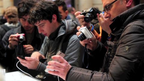 People take pictures of Huawei's new smartphone 'Ascend P2' after a press conference in Barcelona on February 24, 2013.