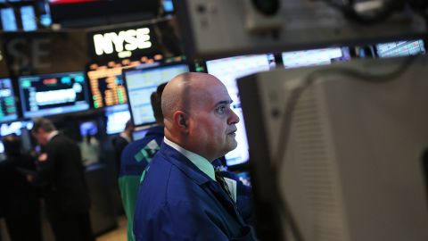 Traders work on the floor of the New York Stock Exchange on February 25, 2013, in New York City.
