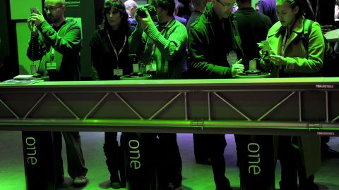 People look at smartphones at the 2013 Mobile World congress in Barcelona on February 25, 2013.