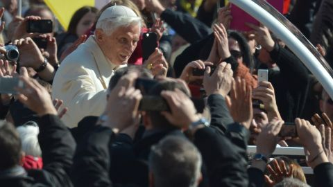 Pope Benedict XVI waves as he arrives on St Peter's square for his last weekly audience on February 27, 2013 at the Vatican. Pope Benedict XVI will hold the last audience of his pontificate in St Peter's Square on Wednesday on the eve of his historic resignation