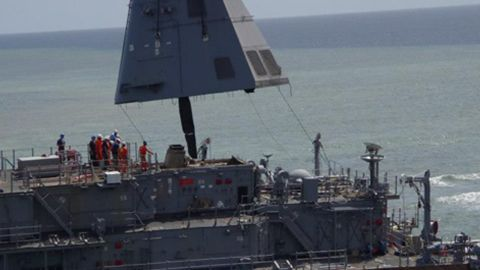 The USS Guardian's funnel section is lifted Tuesday, February 26, as a task force works on removing equipment.