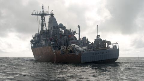 The USS Guardian rocks in the waves on February 8.