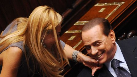 Member of parliament Michaela Biancofiore squeezes Italian Prime Minister Silvio Berlusconi's chin at the Parliament in Rome on August 3, 2011.