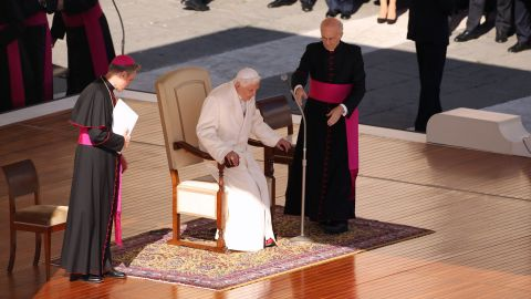 """Benedict takes his seat on the dias in St. Peter's Square. In an unusually personal message, he said there had been """"many days of sunshine"""" but also """"times when the water was rough ... and the Lord seemed to sleep."""""""