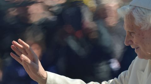 The pope waves to the crowd.