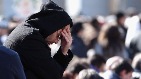 A pilgrim prays as he attends Benedict's final general audience address.