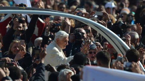 Benedict waves from to the crowd as he arrives at St. Peter's Square.