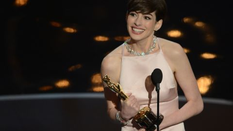 """Love her or <a href=""""http://www.cnn.com/2013/02/28/showbiz/celebrity-news-gossip/anne-hathaway-hate/index.html"""">hate her</a>, Anne Hathaway has had quite the rise to stardom. Here she accepts her best supporting actress Oscar for her role as Fantine in """"Les Miserables"""" on Sunday, February 24. Click through to see some other highlights of Hathaway's career:"""