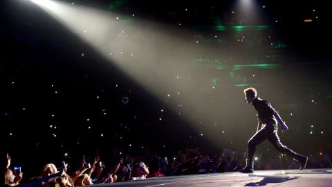 """The Biebs has a knack for concert mishaps. He managed to <a href=""""http://marquee.blogs.cnn.com/2012/06/01/justin-bieber-runs-into-glass-again-vows-revenge/"""">run into a wall of glass backstage</a> in Paris in June 2012, and in the fall of that year, <a href=""""http://marquee.blogs.cnn.com/2012/10/01/bieber-gets-sick-on-stage-milk-was-a-bad-choice/"""">he got sick onstage</a> before moving on with his performance in Glendale, Arizona. Here he performs at the Staples Center in Los Angeles in October 2012."""