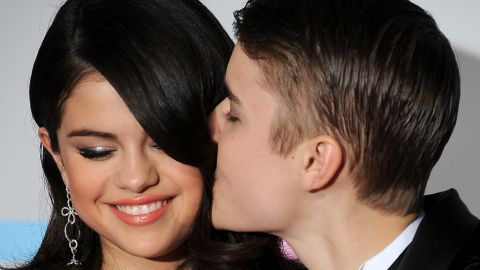 """Bieber was embroiled in <a href=""""http://marquee.blogs.cnn.com/2011/11/02/bieber-denies-fathering-child-with-20-year-old/?iref=allsearch"""">a baby mama scandal </a>when he attended the 2011 American Music Awards with Selena Gomez, but you wouldn't know it by looking at the happy couple. A year later, Bieber and Gomez would no longer be an item."""