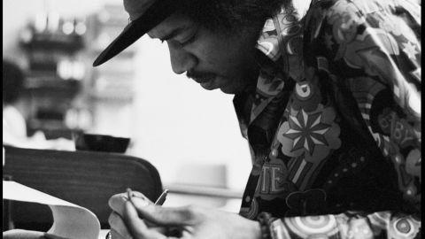"""<strong>Hendrix at the Record Plant in 1968:</strong><br />""""Jimi had the habit of making the final draft of a song he was working on just before he went into the booth to record the vocal. This photo shows a smiling Jimi putting the final touches to 'Gypsy Eyes' from the many notes he kept with him usually written on hotel stationery, napkins or matchbook covers. These would be assembled on a yellow legal pad just prior to singing the final vocal. An interesting observation is that he wrote right-handed even though he played lefty.""""  --<em> Eddie Kramer</em>"""