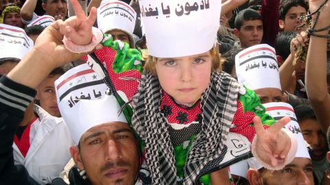 An Iraqi boy wears a placard reading 'Baghdad we are coming' during rally on March 1, 2013 in Hawijah, near Kirkuk.