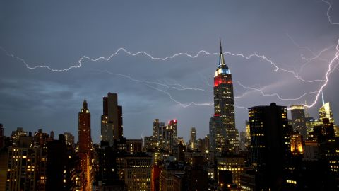 """<a href=""""http://ireport.cnn.com/docs/DOC-821097"""">Matthew Burke</a> shot this dramatic lightning strike from his Manhattan apartment window in July 2012. """"There was very strong rain and wind for about 15 minutes, at which point the rain cleared and the lightning show began,"""" he said."""
