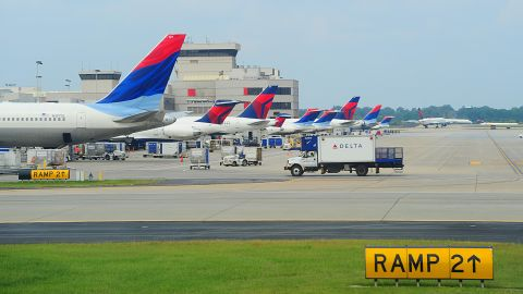 Officials are trying to find out how a woman got through security and ended up on the tarmac at the Atlanta airport last month.
