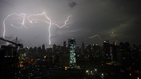 Lightning strikes over Jakarta's skyline late on March 3 during monsoon rains.