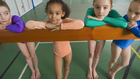 Whether or not your child is destined to become an Olympic gymnast, it's critical to teach kids they're not defined by what they do, but by who they are, says Bloom.
