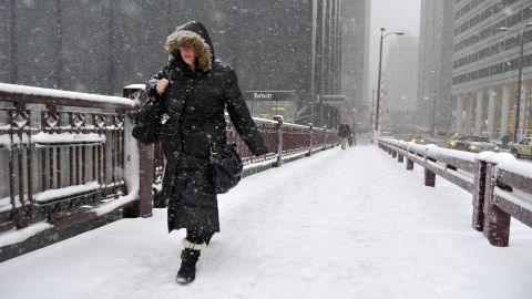 Jennifer Mosby crosses the Adams Street Bridge over the Chicago River on March 5 in the Windy City.