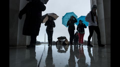 Tourists battle rain at the Lincoln Memorial on March 6.