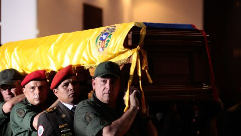 The coffin of the late Venezuelan President Hugo Chavez is carried Wednesday to the Military Academy for his funeral in Caracas.