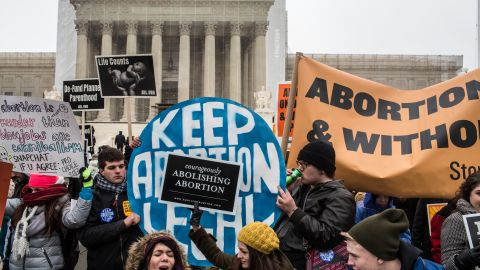 Pro-life and pro-choice protesters rally outside the U.S. Supreme Court, near the U.S. Capitol, during the March for Life on January 25, 2013 in Washington, DC.