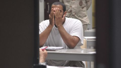 """A detainee rubs his face while attending a """"life skills"""" class in April 2009."""