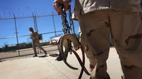 A guard holds shackles before preparing to move a detainee in September 2010.