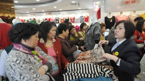 Women shop at a woman's clothes store in Shanghai with discounts for International Women's Day on March 8, 2013. International Women's Day in China is celebrated with various events including discount shopping for women at malls in cities around China.