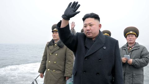 North Korean leader Kim Jong Un (center) waves to soldiers from a boat as he inspects the Mu Islet Hero Defence Detachment near South Korea's Taeyonphyong Island.