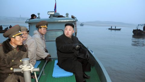Kim arrives at Jangjae Islet by boat to meet with soldiers of the Jangjae Islet Defense Detachment in March 2013.
