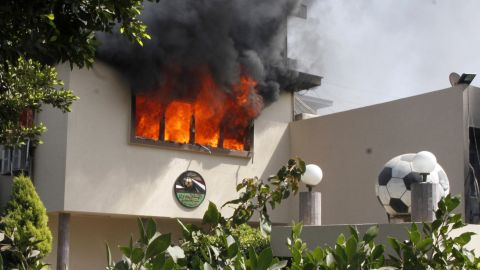 Flames rise from a room at the headquarters of the Egyptian Football Association in Cairo on March 9.