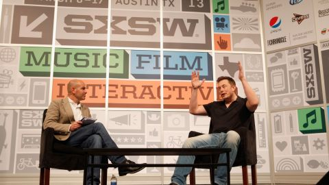 SpaceX CEO Elon Musk, right, on Saturday describes stressful moments during the company's Dragon mission to the International Space Station.