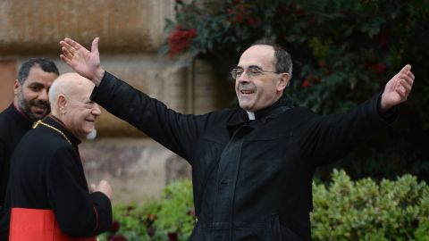 French Cardinal Philippe Barbarin greets colleagues as he arrives for a pre-conclave meeting on Saturday, March 9.