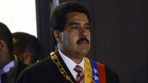 Venezuelan acting president Nicolas Maduro leaves after the ceremony in which he was sworn in, on March 8, 2013, in Caracas.