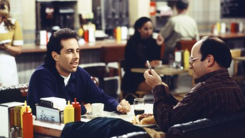 """True, """"Seinfeld"""" also technically launched in 1989 -- but what are the '90s without Jerry Seinfeld (left), George Costanza (played by Jason Alexander, right), Kramer and """"<a href=""""http://www.youtube.com/watch?v=DY_DF2Af3LM"""" target=""""_blank"""" target=""""_blank"""">The Elaine</a>""""?"""