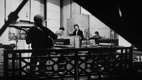 """The Beatles are seen recording their seventh album, """"Revolver,"""" at Abbey Road Studios in April 1966 before embarking on a world tour. Revolver was released in August that year and went straight to No. 1 in the U.S. and UK."""