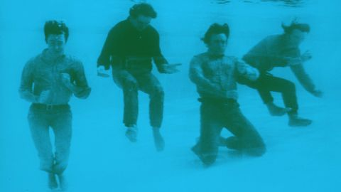 """The Beatles pose fully-dressed underwater in the pool of the Nassau Beach Hotel in the Bahamas where they were filming their comedy movie """"Help!"""" Freeman was with them on set."""