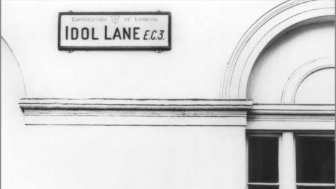 Paul McCartney stands beneath this apt East London road sign, Idol Lane, in 1965 at the peak of the Beatles' career.