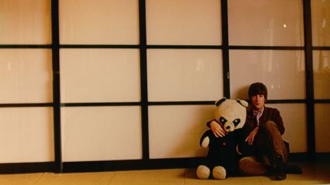 This picture, taken in around 1965, shows Lennon holding his son Julian's toy panda in a Japanese room. The print is has become one of the top sellers in the collection.