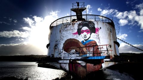 """Irish artist <a href=""""http://findac.tumblr.com/"""" target=""""_blank"""" target=""""_blank"""">Fin Dac</a>, created this piece, called """"Mauricamai,"""" which stretches the height of the ship's stern. """"I create my art to keep myself happy. If others like it then that's a great by-product,"""" he said."""