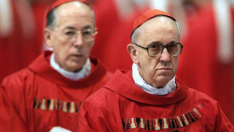 "Bergoglio, right, and Peru's Cardinal Juan Luis Cipriani Thorne attend the special ""pro eligendo summo pontifice"" (to elect supreme pontiff) Mass in Vatican City in April 2005."