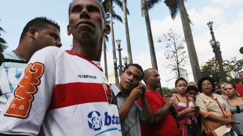 People gathered outside the Se Cathedral in in Sao Paulo listen to the announcement of the new pope on March 13.