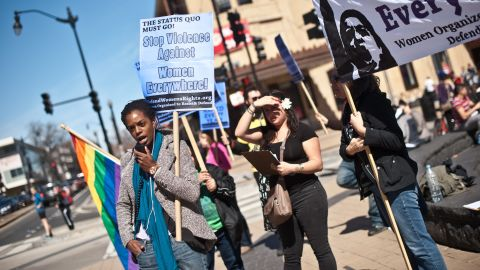 Protesters note the issue of domestic violence doesn't apply only to heterosexuals.