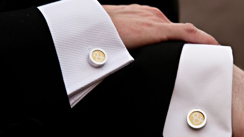 """Detail shots offer a chance to capture the symbols and subtle touches of a wedding. """"Photographing a groom's cuff links comes straight (ahem) from the traditional playbook,"""" Hamm said. Here, that classic shot is reinvented by capturing different men's shirts to signify that two people are in the frame."""