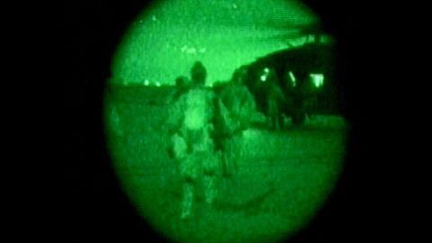 A night-vision image shows U.S. military personnel carrying Pfc. Jessica Lynch off a helicopter on April 1, 2003, at an undisclosed location in Iraq. She had been missing since March 23, when she and members of her unit were ambushed by Iraqi forces.