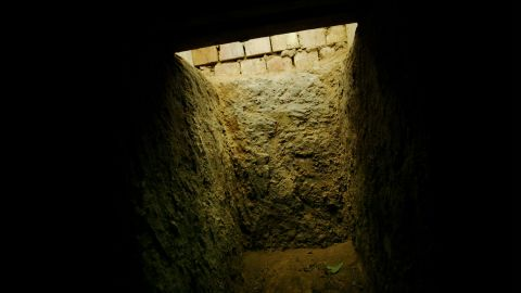 """The entrance to the """"spider hole"""" where Saddam Hussein was hiding in Ad Dawr is seen from the inside on December 15, 2003."""