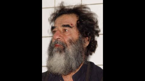 Saddam Hussein's picture is taken December 14, 2003, after his capture a day earlier. U.S. troops found Hussein hiding near his hometown of Tikrit.