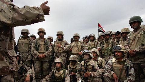 Members of the Iraqi Intervention Forces listen to last-minute instructions before heading out with U.S. troops to begin a major offensive on the insurgent stronghold of Fallujah on November 8, 2004.